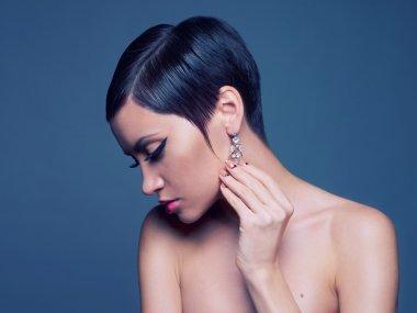 Sensual lady with diamond earring