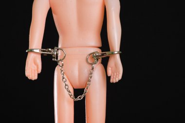 Toy men with handcuff