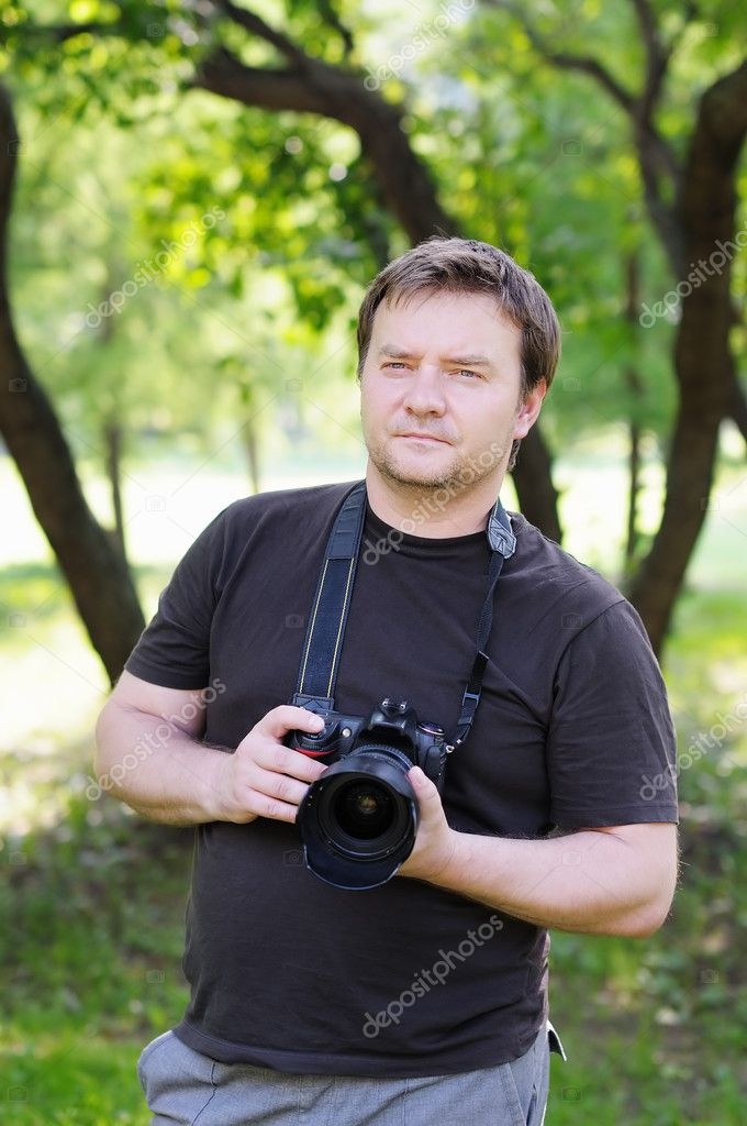 Man with professional digital camera