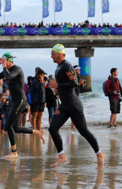 Triathlete running out of water