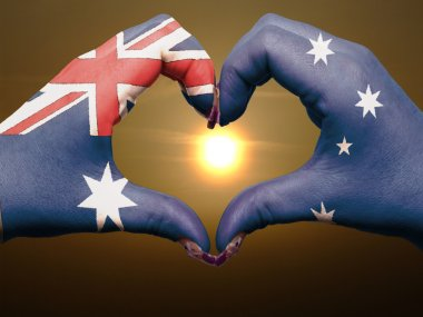 Heart and love gesture by hands colored in australia flag during