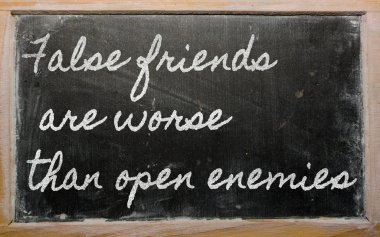 Handwriting blackboard writings - False friends are worse than open enemies stock vector