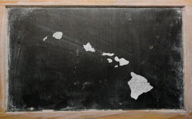 Outline map of us state of hawaii on blackboard