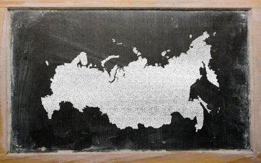Outline map of russia on blackboard