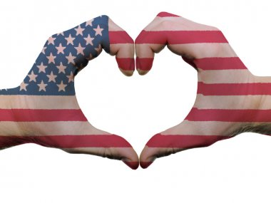 Heart and love gesture in usa flag colors by hands isolated on w