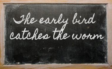 Expression - The early bird catches the worm - written on a sch
