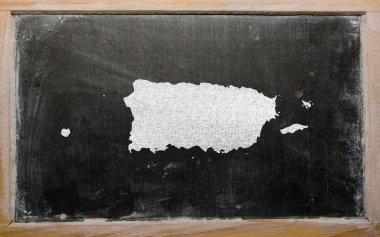 Outline map of puerto rico on blackboard