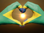 Fotografie Heart and love gesture by hands colored in brazil flag during be