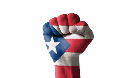 Fist painted in colors of puertorico flag