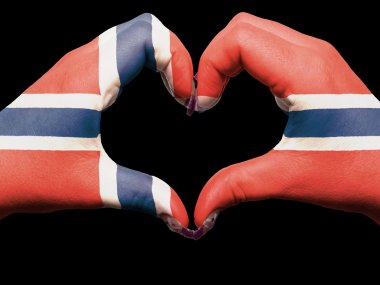 Heart and love gesture by hands colored in norway flag for touri