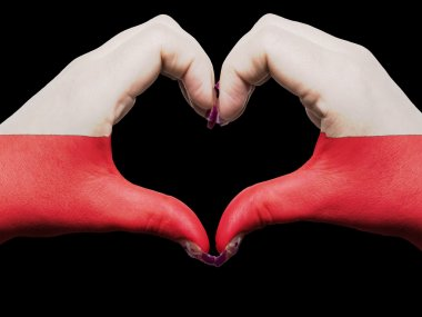 Heart and love gesture by hands colored in poland flag for touri