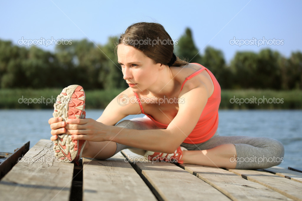 Woman doing stretching exercis