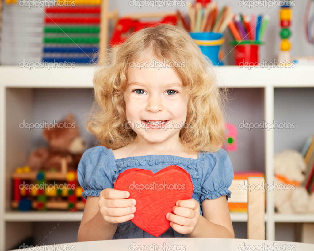 Happy child with paper heart