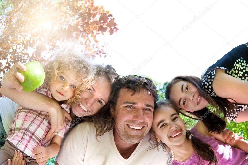 Happy family having fun in summer park stock vector
