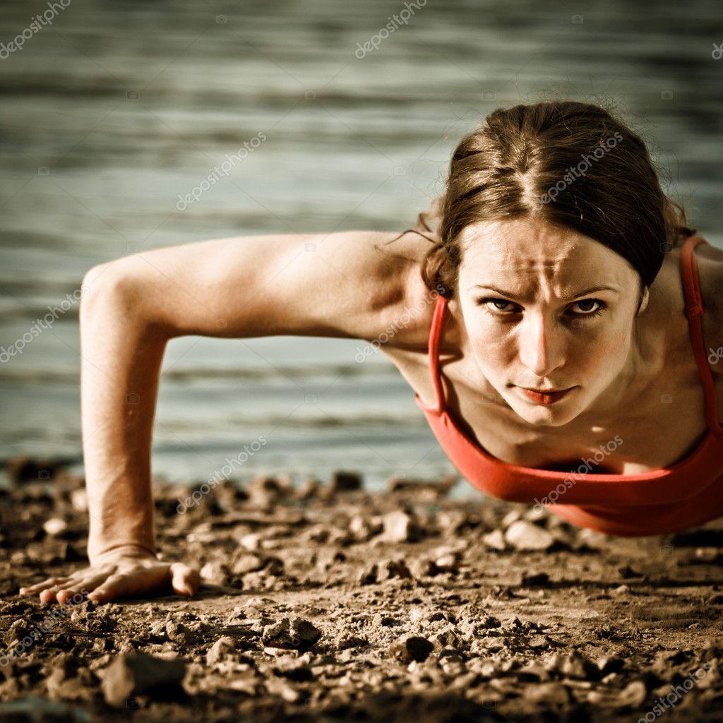 Strong woman doing pushup