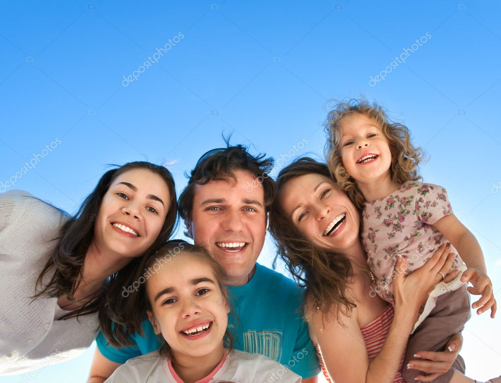 Group of happy smiling friends: man, women and kids having fun outdoors against blue sky background. Summer vacations concept stock vector
