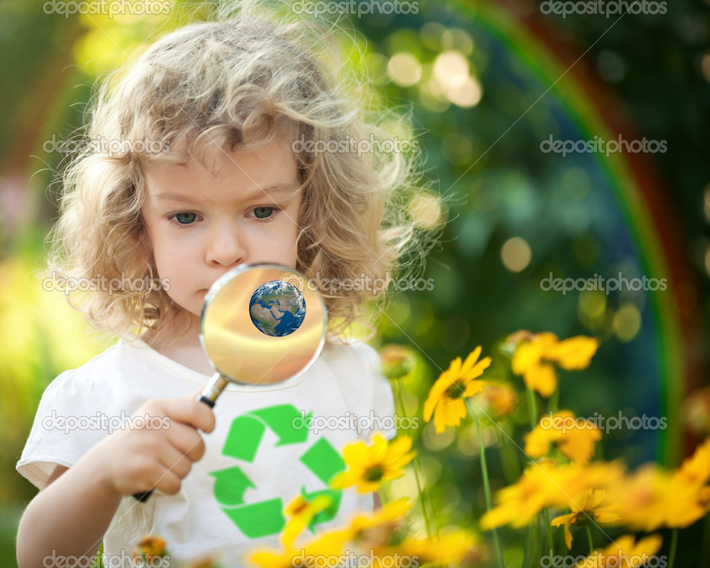 Child looking at spring flowers