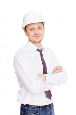 Engineer with white hard hat standing confidently isolated on wh