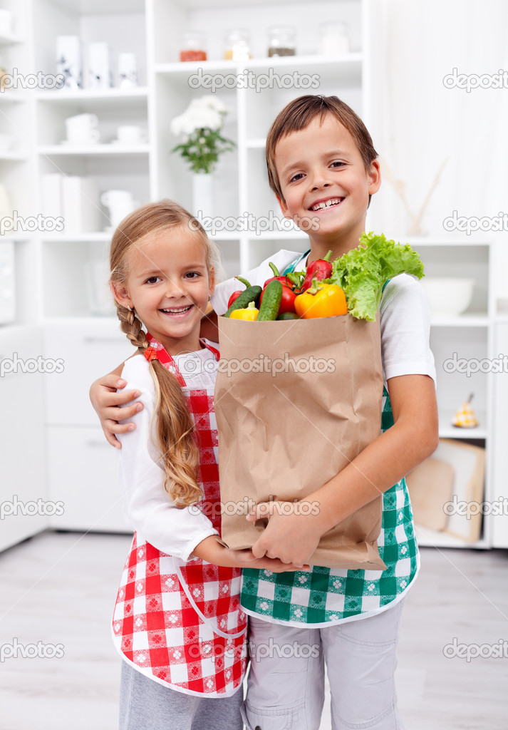 Happy Healthy Kids With The Grocery Bag In The Kitchen