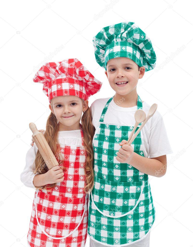 Happy kid chefs with wooden cooking utensils