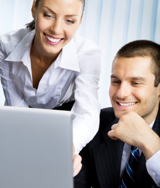 Two business working with laptop
