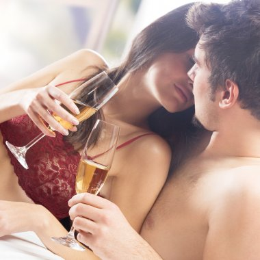Young happy couple with champagne