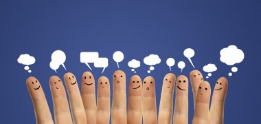 Happy group of finger smileys with social chat sign and speech bubbles.