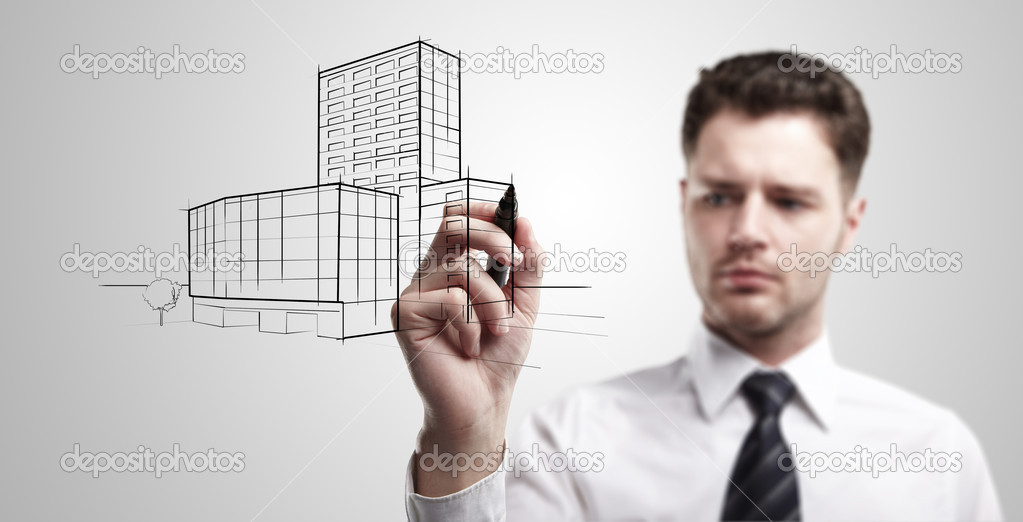 Business man drawing a project of building on a glass window