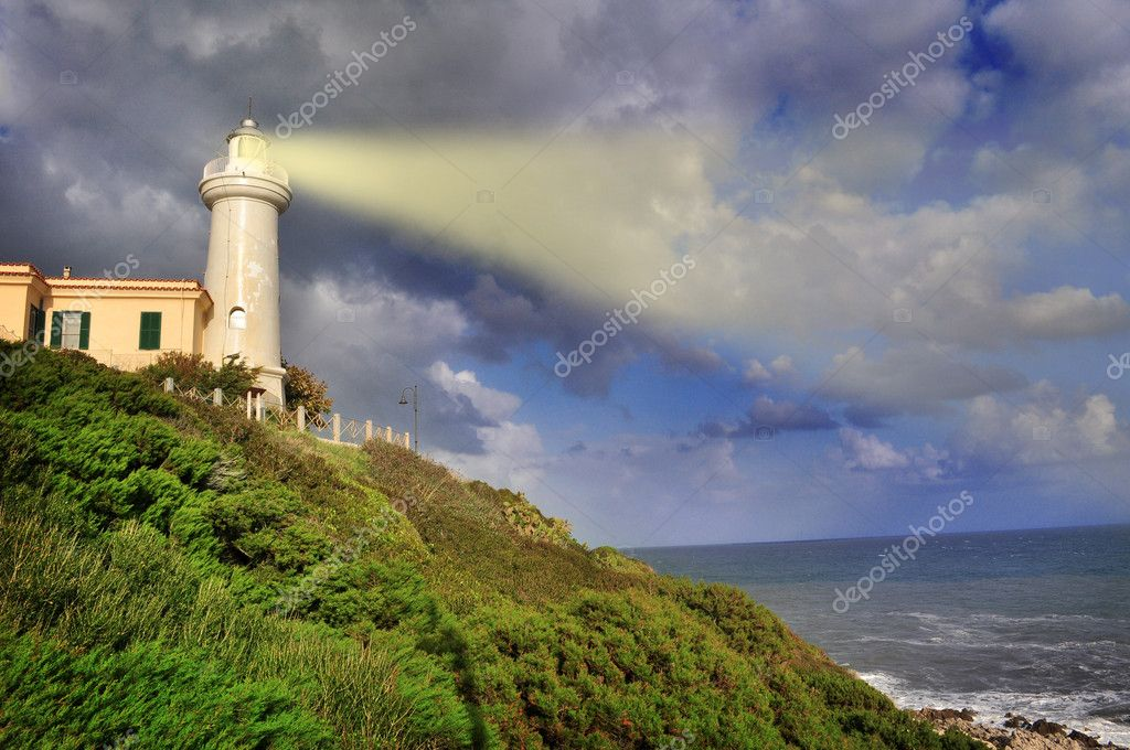 Lighthouse lights the sea — Stock Photo © rossosiena #10072326
