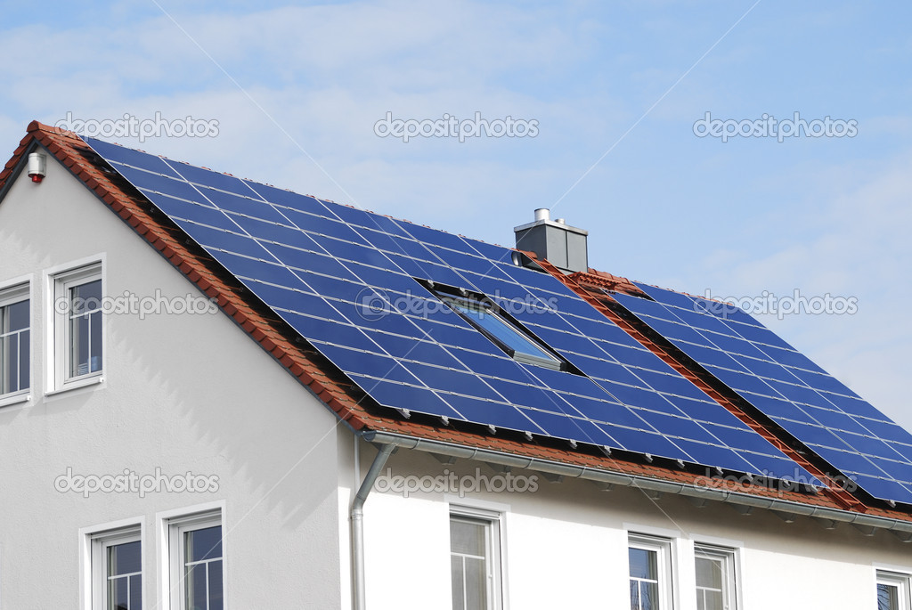Modern House Roof With Solar Panels Stock Photo