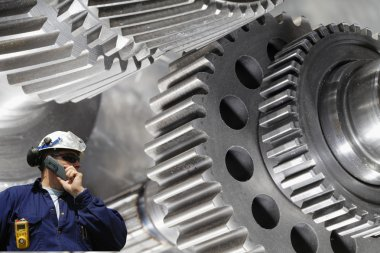 Metal worker with giant machinery