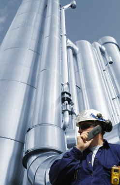 Industry worker and gas pipes