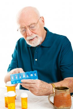 Senior Man Sorting Pills