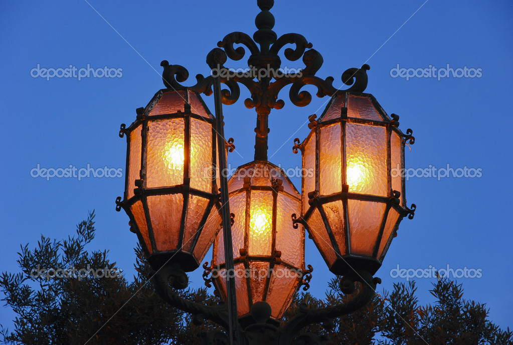 Street lamps glowing in the dark at Malta