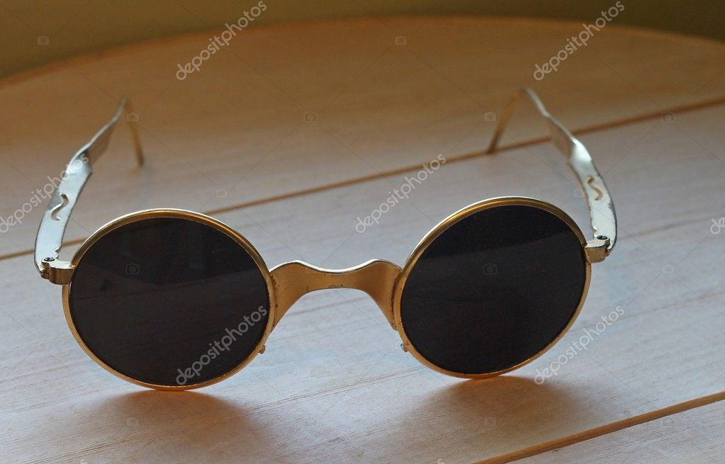 da118879a3a8 Close up of unusual vintage sunglasses sitting on wood. — Photo by  mcornelius