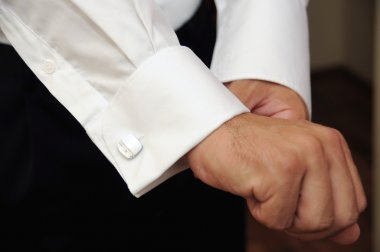 Groom Hands of wedding groom getting ready in suit
