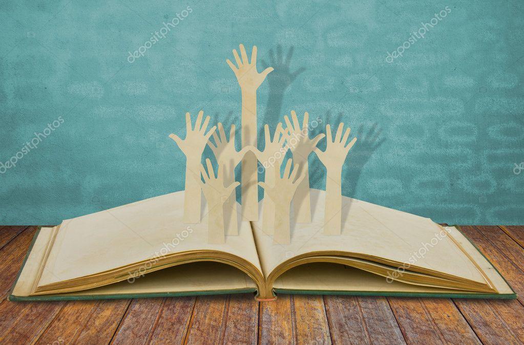 Paper cut of Hands volunteering