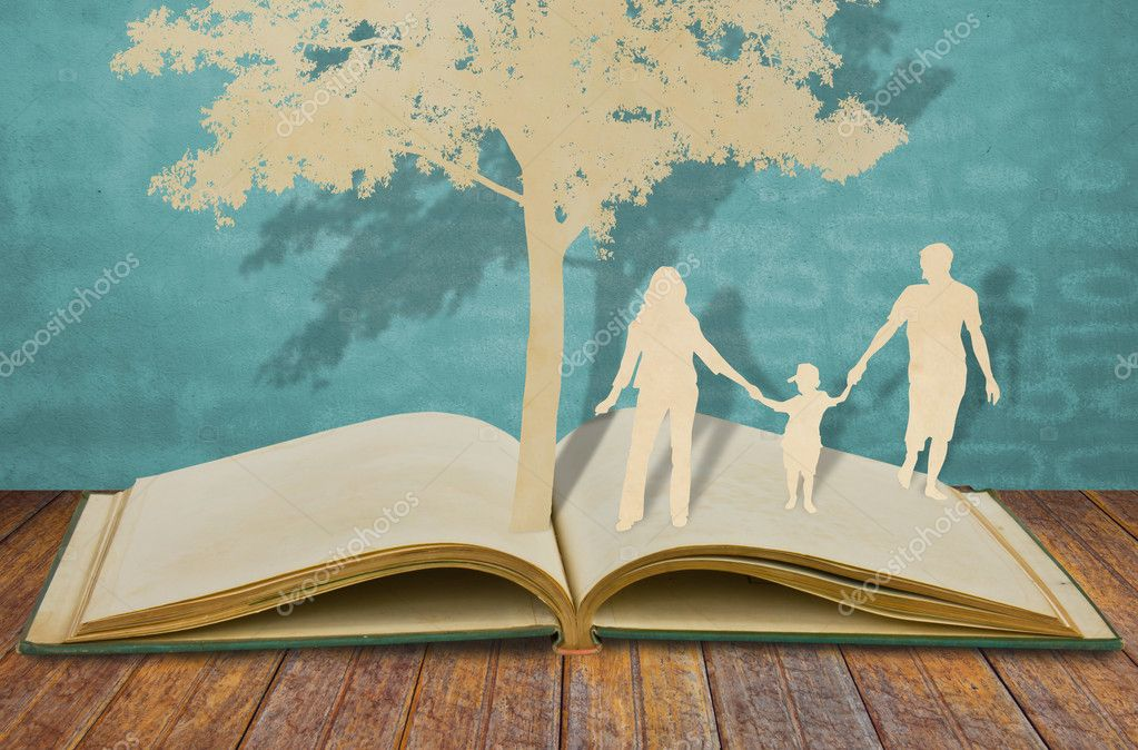 Paper cut of family symbol under tree on old book