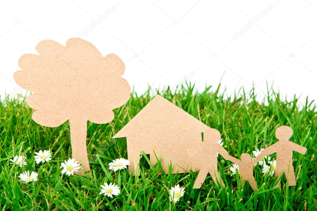 Paper cut of family with house and tree on fresh spring green