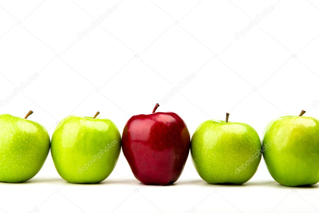 Red apple among green apples isolated on a white