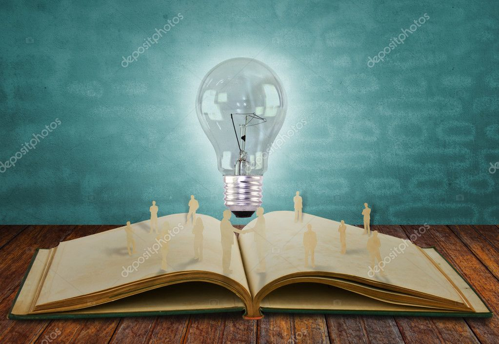 Paper cut of business and light bulb on book