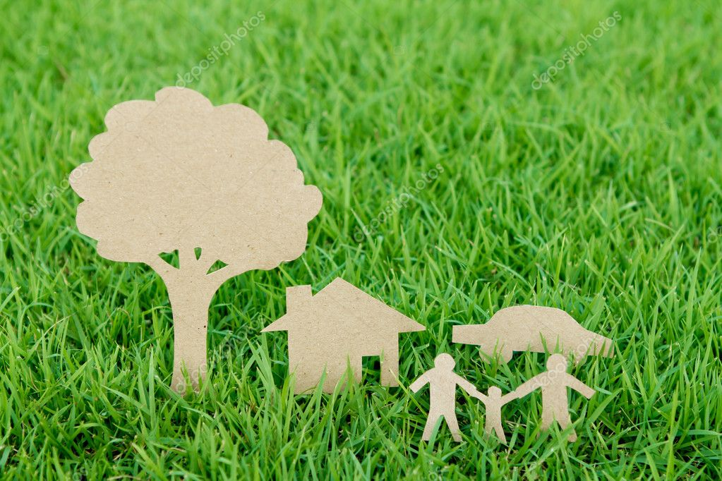 Paper cut of family with house , tree and car on fresh spring gr