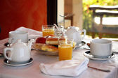Continental breakfast with orange juice, fruit and coffee
