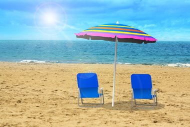 Two chairs with umbrella at the beach stock vector