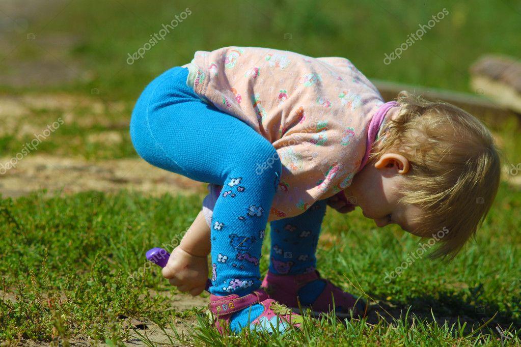 Fun girl playing in the sandbox