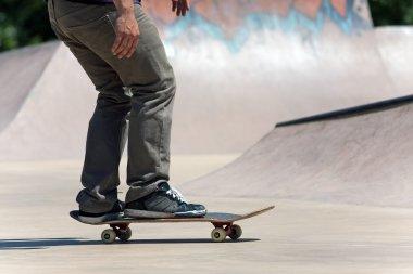 Skateboarder on the Concrete Skate Park