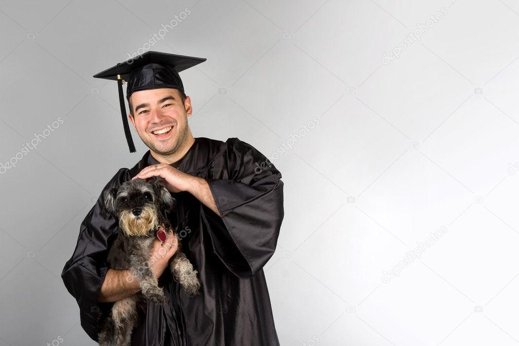 Graduate Holding Dog — Stock Photo © ArenaCreative #9239517