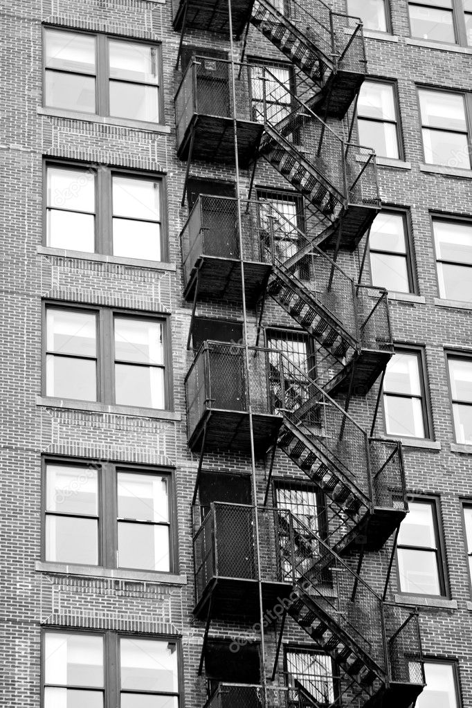 Lovely Exterior Fire Escape Stairs On The Outside Of An Old Brick Building In  Black And White. U2014 Photo By ArenaCreative