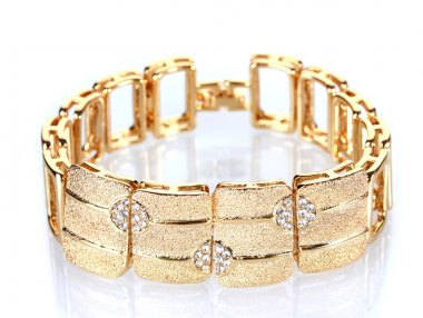 Beautiful golden bracelet with precious stones isolated on white