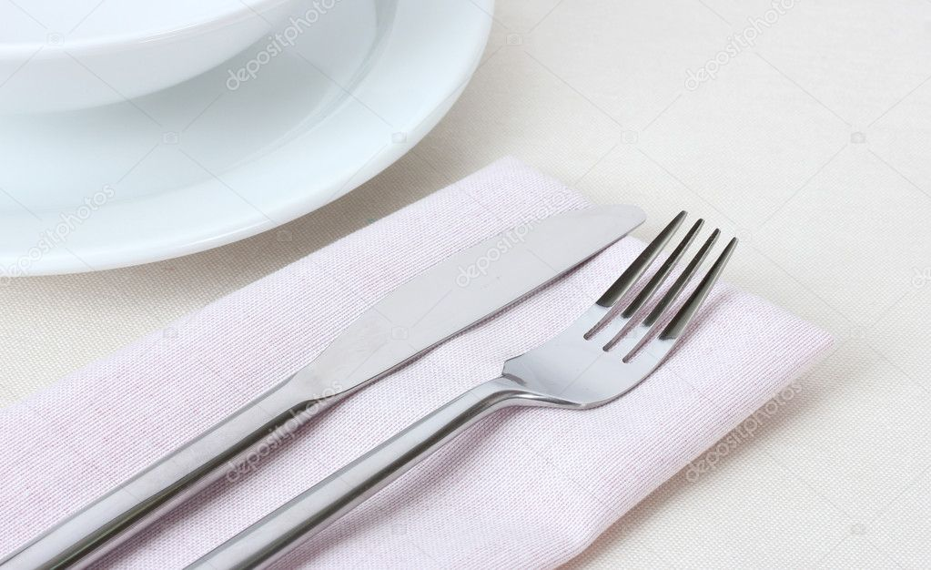 Table setting with fork knife plates and napkin \u2014 Stock Photo & Table setting with fork knife plates and napkin \u2014 Stock Photo ...